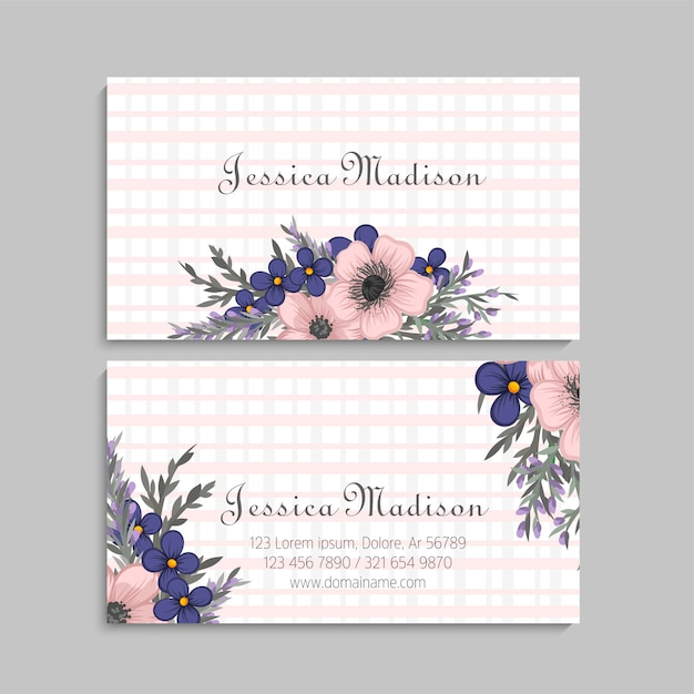 Business card with beautiful flowers. Premium Vector