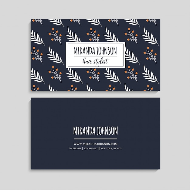 Business card with beautiful flowers. Free Vector