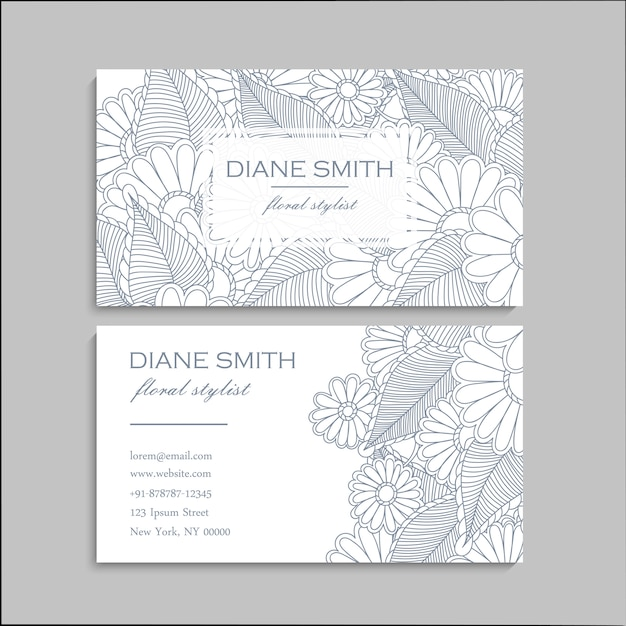 Business card with beautiful flowers Free Vector