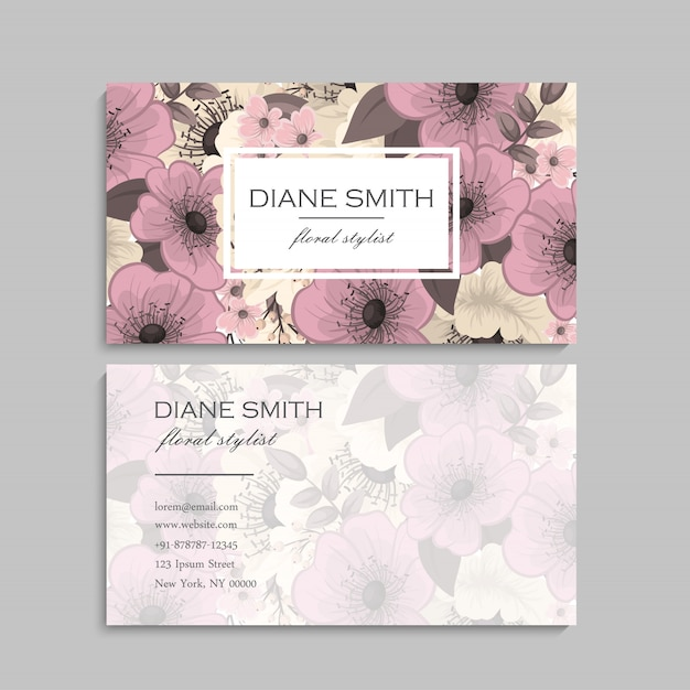 Business card with beautiful pink flowers Free Vector