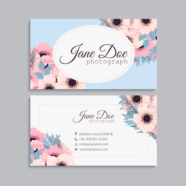 Business card with beautiful pink flowers. Free Vector