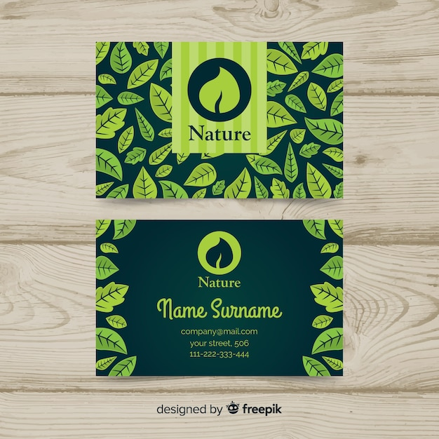 Business card with leaves design Free Vector