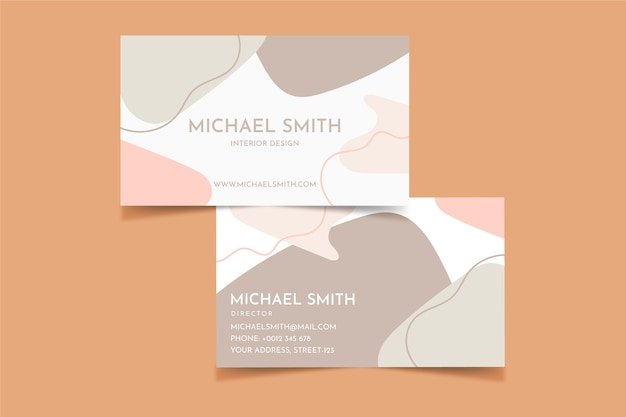 Business card with pastel-colored stains Free Vector