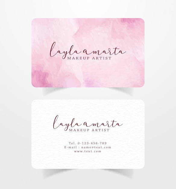 Business card with pink brushstrokes watercolor template Premium Vector