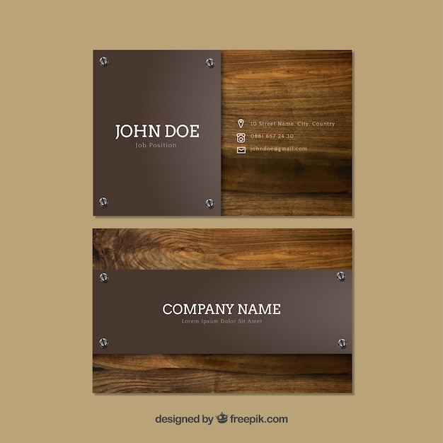 Business cards with wooden background Free Vector