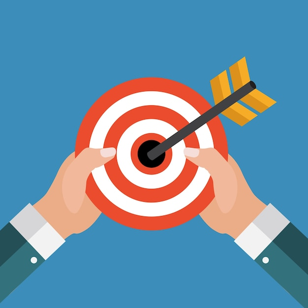 Business concept with hand of businessman hold target Premium Vector