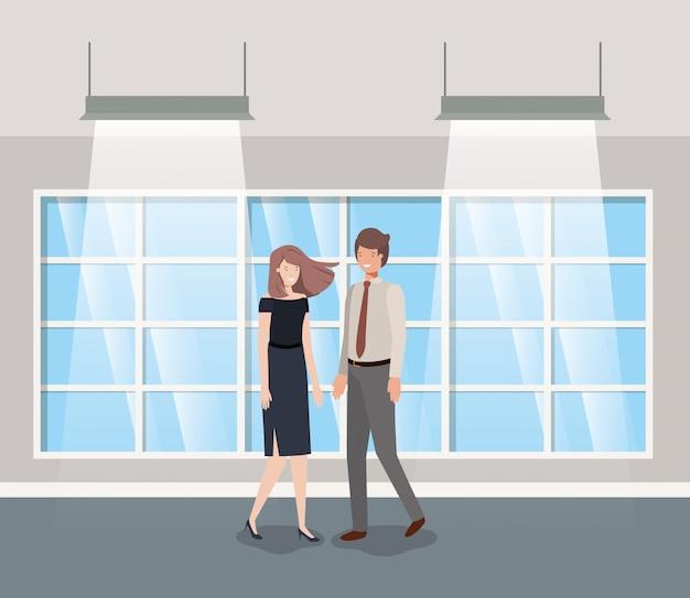 Business couple in corridor office Premium Vector