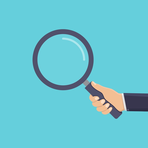 Business hand holding a magnifying glass Premium Vector