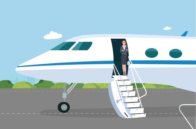 開いた乗客のドアと離陸場のスロープを備えたビジネスジェットスチュワーデスは、通路で乗客に会います Premiumベクター