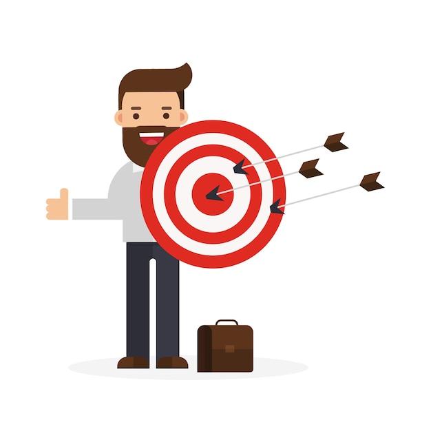 Business man holding big aim target Premium Vector