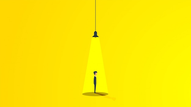 Business man under the light of a lamp Premium Vector