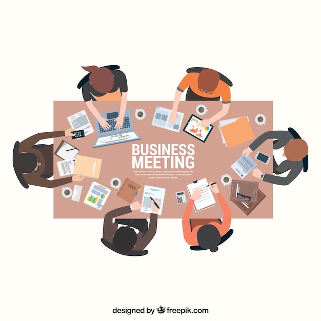 Business meeting scene on rectangular\ table