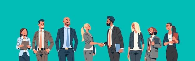 Business people group handshake banner Premium Vector
