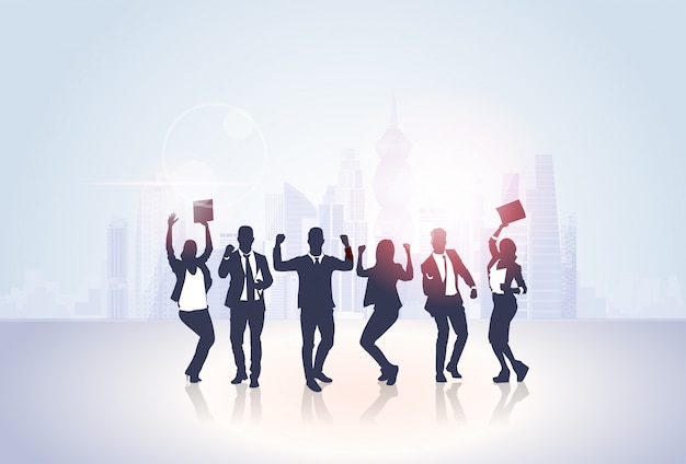 Business people group silhouette excited hold hands up raised arms, businesspeople concept winner success Premium Vector