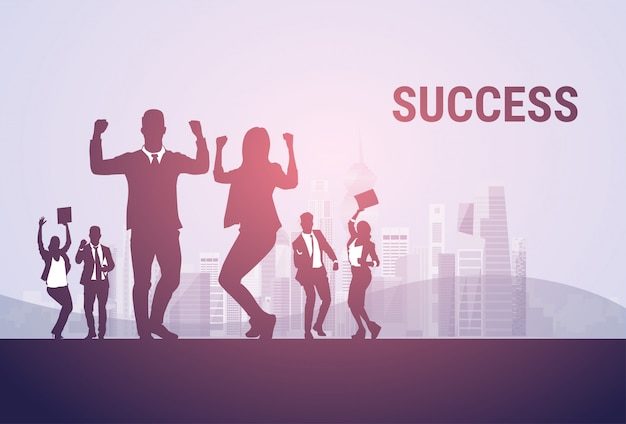 Business people group silhouette excited hold hands up raised arms Premium Vector