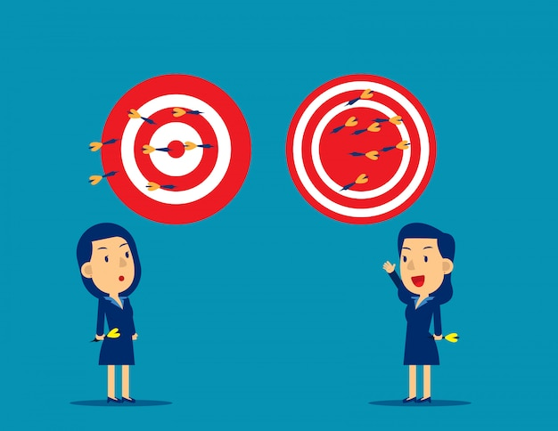 Business person throwing darts at dart board Premium Vector