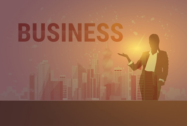 Business woman black silhouette open palm to copy space over modern city background Premium Vector