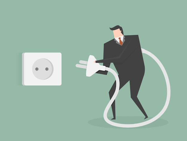 Businessman connecting a plug Free Vector