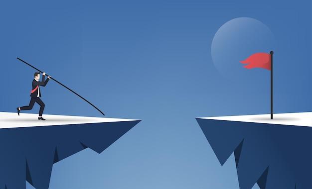 赤旗の概念を飛び越えるために棒高跳びをしているビジネスマン。 Premiumベクター