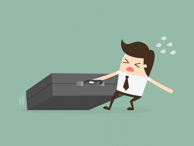 Businessman dragging huge briefcase. hard working. Premium Vector
