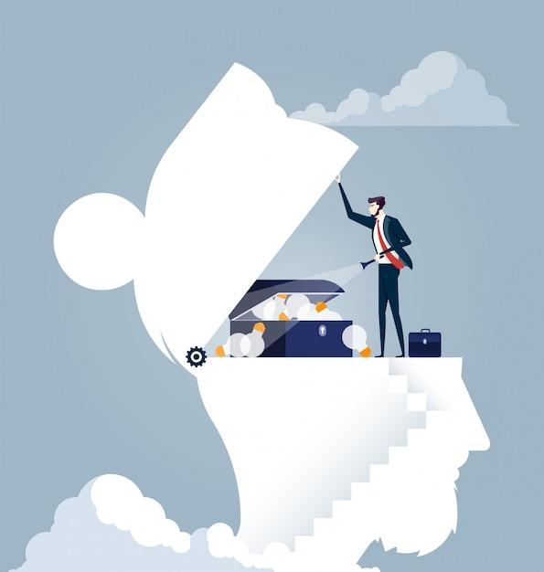 Businessman finding a idea treasure in a head Premium Vector