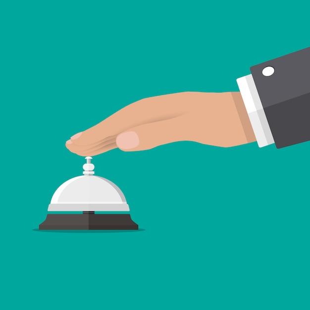 サービスの鐘が鳴っているビジネスマン手 Premiumベクター