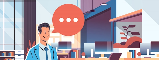 Businessman holding tablet speech chat bubble icon banner Premium Vector