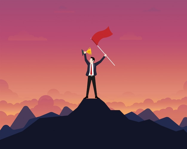 Businessman holding up a gold trophy cup with success flag on top of mountain Premium Vector