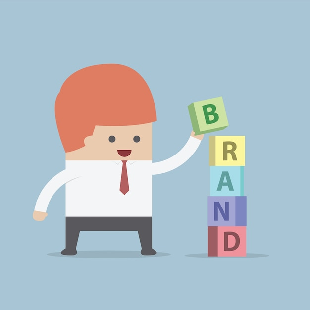Businessman is building brand word, brand building concept Premium Vector