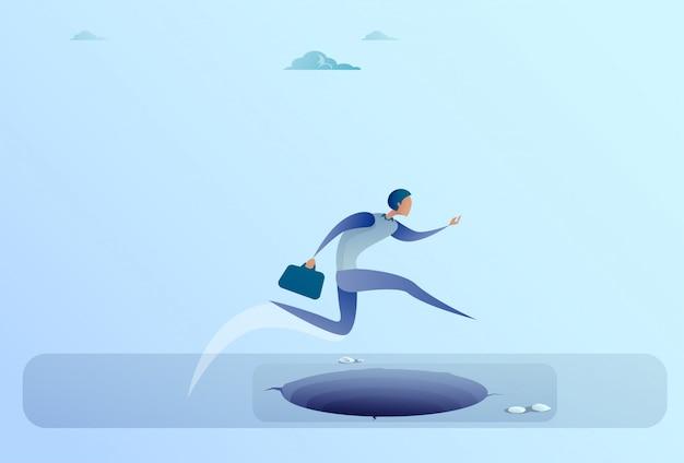 Businessman jump over gap to success business man risk concept Premium Vector
