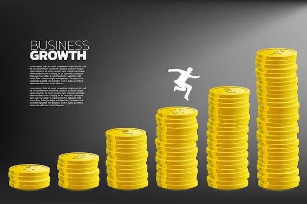 Businessman jump to higher column of money graph. Premium Vector