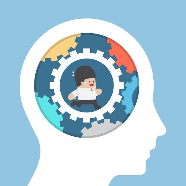 Бизнесмен, работающий в снаряжении внутри головы, улучшает идею и концепцию интеллекта Premium векторы