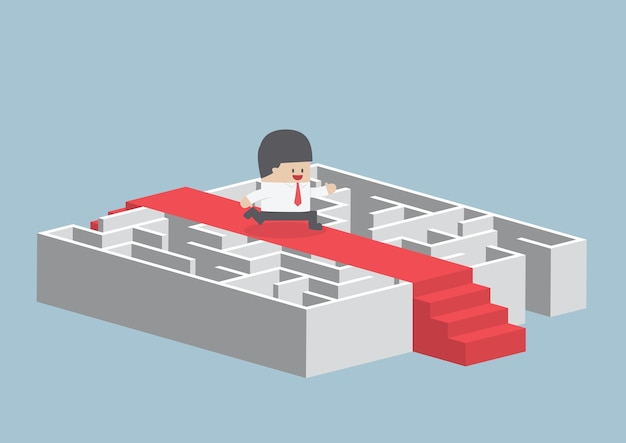 Businessman running on the red carpet over the maze Premium Vector