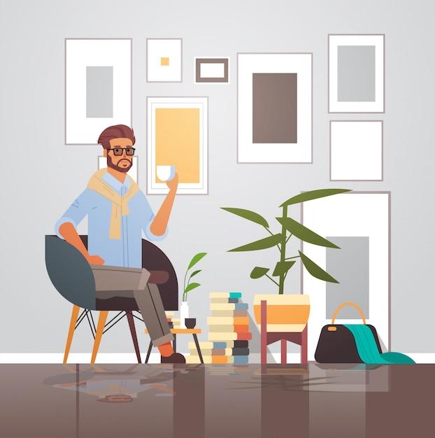 Businessman sitting on armchair business man having coffee break male cartoon character full length Premium Vector