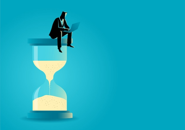 Businessman sitting with laptop on hourglass Premium Vector