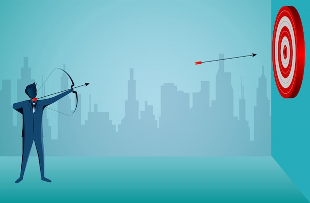 Businessman standing shooting an arrow to the target in the center of the red circle. Premium Vector
