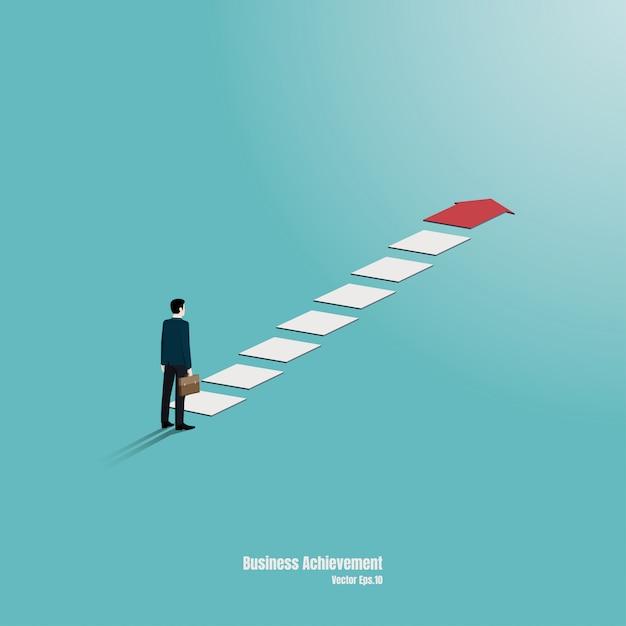 ビジネスマンはグラフの上部を見つめるように立っています。目標、成功、野心、達成、および課題のビジネスコンセプトの矢印。 Premiumベクター