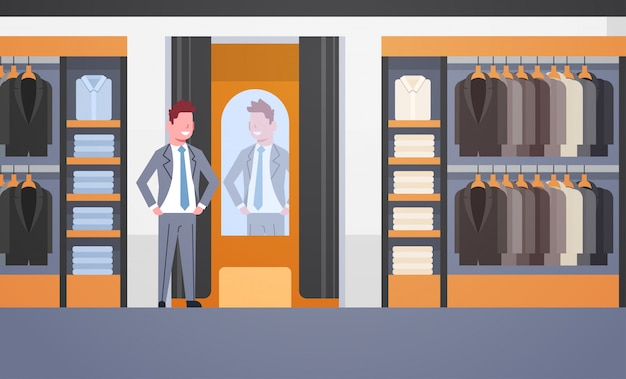Businessman trying on new business suit Premium Vector
