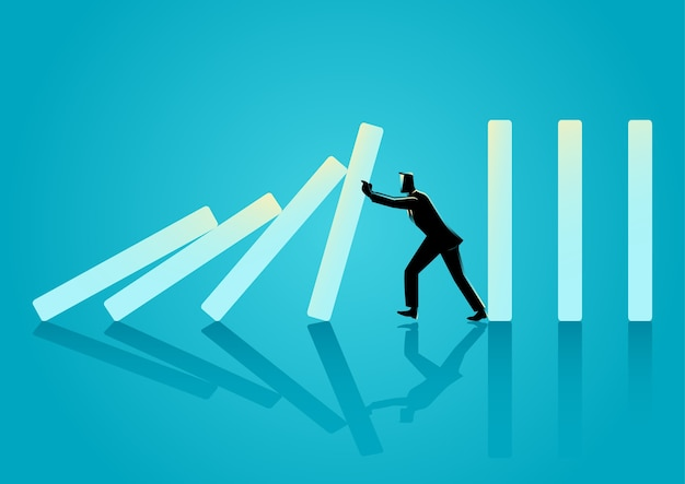 Businessman trying to stop domino effect Premium Vector