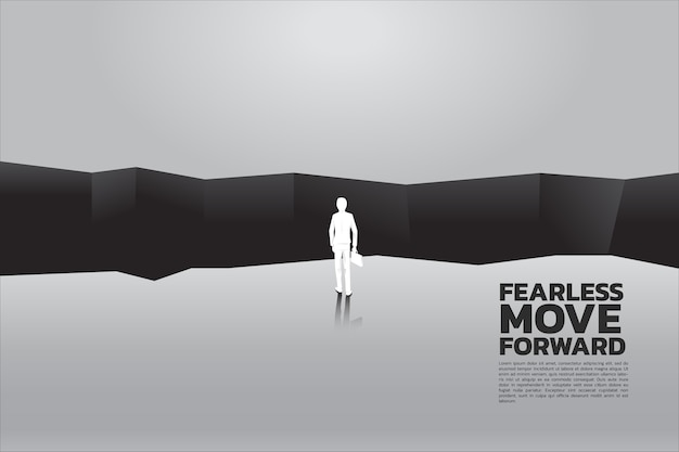Businessman with briefcase step forward to abyss. Premium Vector