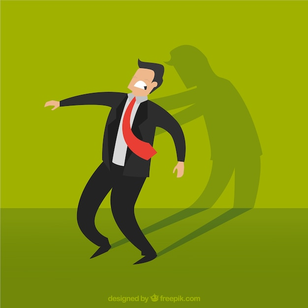 Businessman with his devil shadow Free Vector