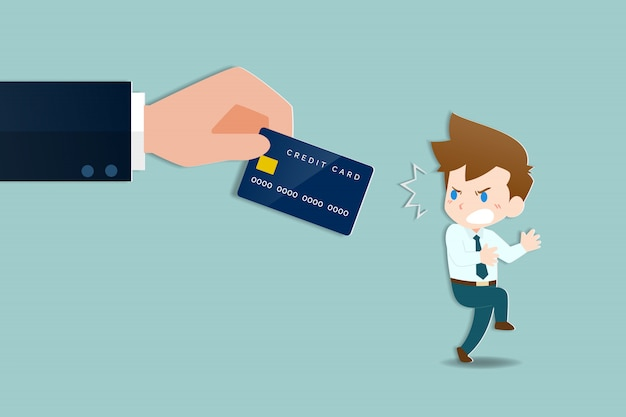 Businessmen were shocked a large hands holding a credit card. Premium Vector