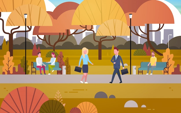 Businesspeople walking through autumn park over people having rest relaxing sit on bench and communicate outdoors Premium Vector