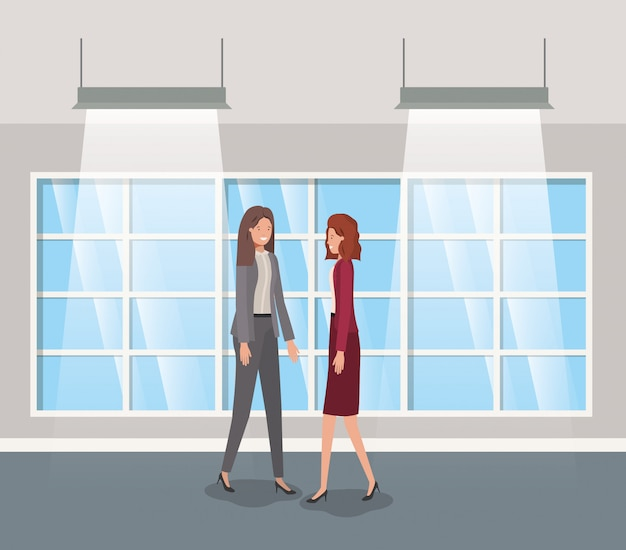 Businesswomen couple in corridor office Premium Vector