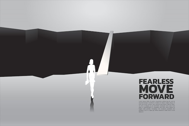 Businesswomen with briefcase step forward to cross abyss. Premium Vector