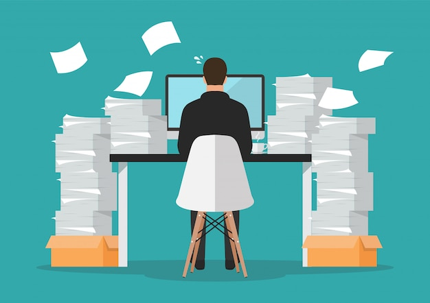 Busy businessman working on computer with pile of papers Premium Vector