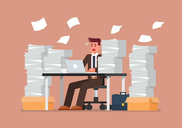 Busy overworked man sitting at table with laptop and pile of papers in office Premium Vector