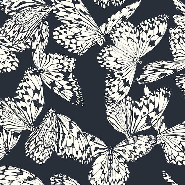 Butterfly seamless pattern in black and white on deep blue Premium Vector