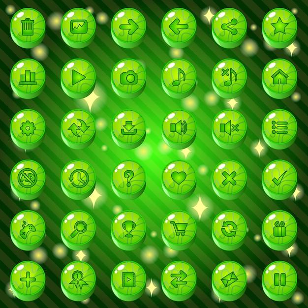Кнопки и набор значков для игры или веб-темы имеют зеленый цвет. Premium векторы