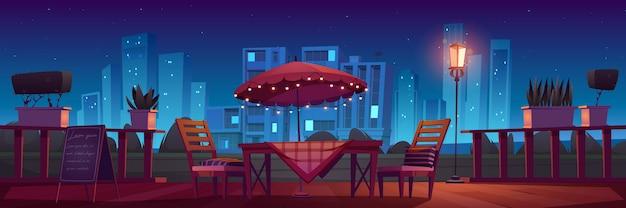 밤에는 카페 또는 레스토랑 테라스 무료 벡터